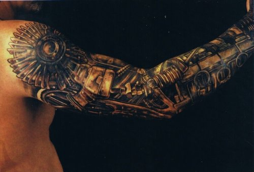 Alien-style arm sleeve tattoo